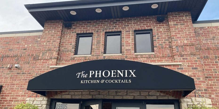 The Front of The Phoenix (brick exterior and awning)